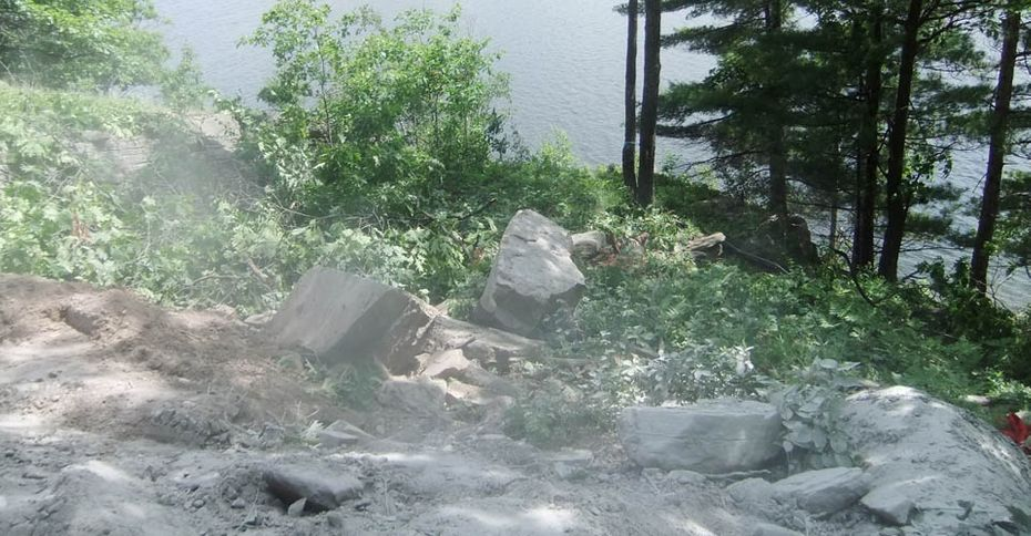 Before: Dusty rocks overlooking a lake