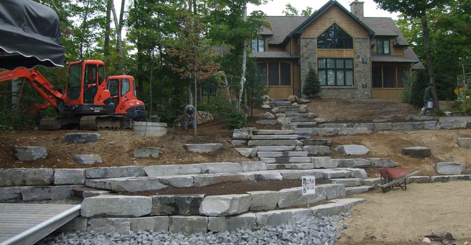 After: A house with a hill terraced with stone slabs