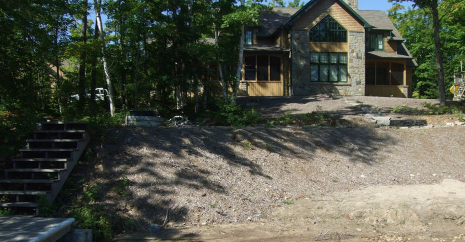 Before: A house with a hill lacking landscaping