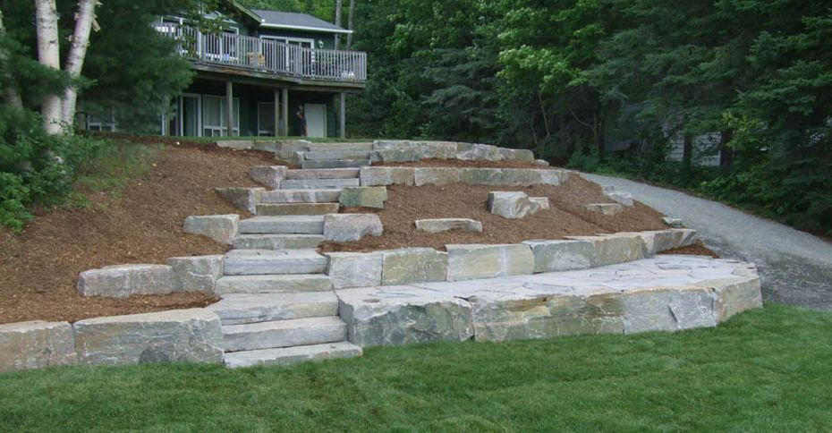 After: A hill terraced with stone slabs and mulch