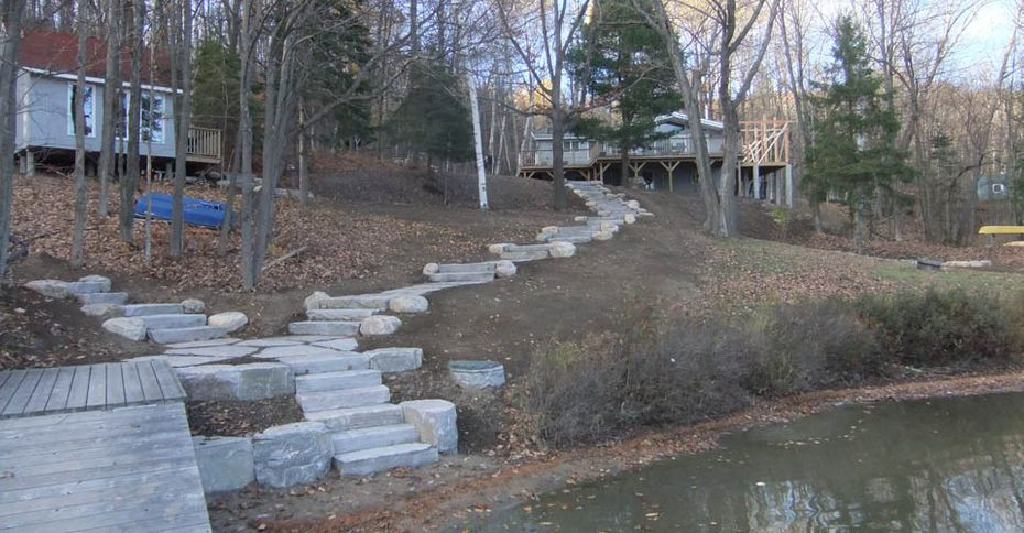 After: A stone pathway down from a house to the wooden dock